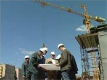 будівельники